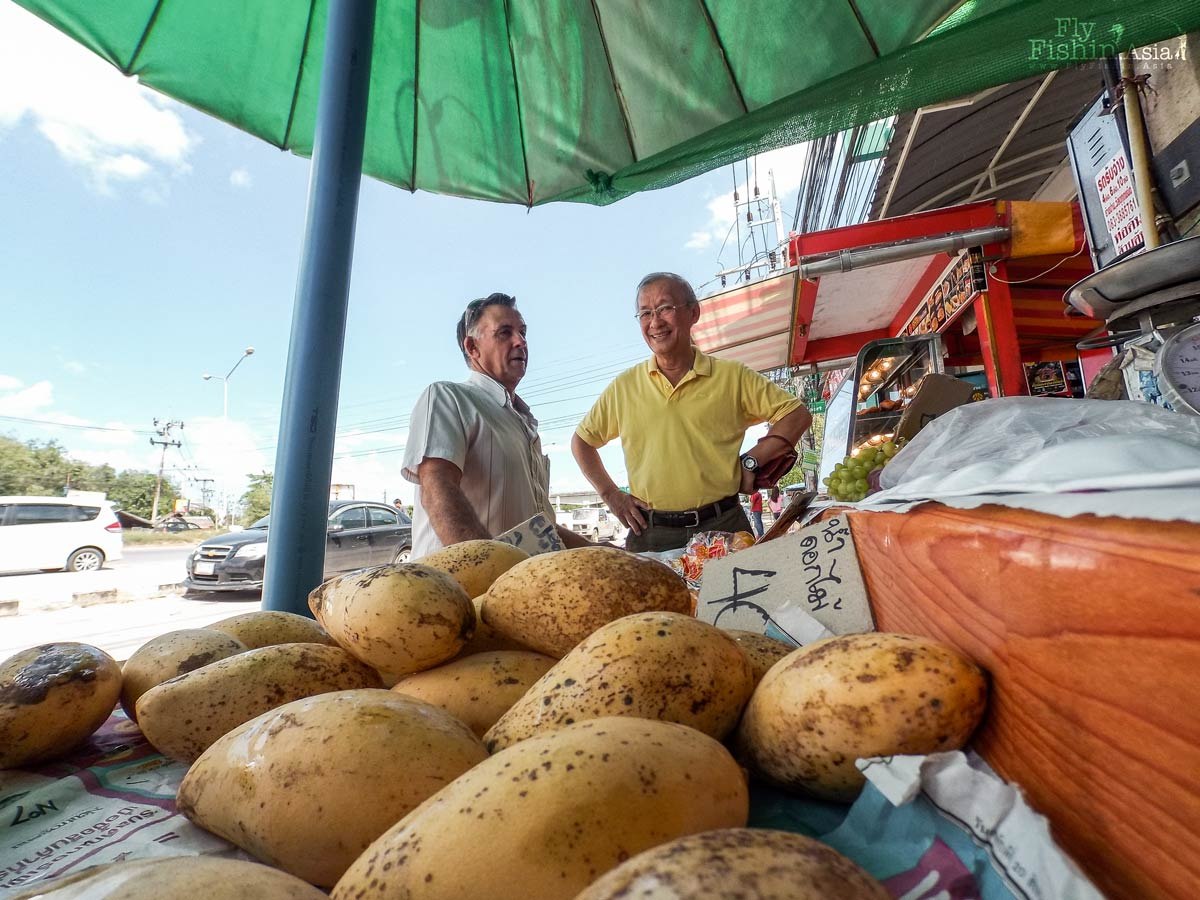 Tim and Tony admiring some thai mangoes