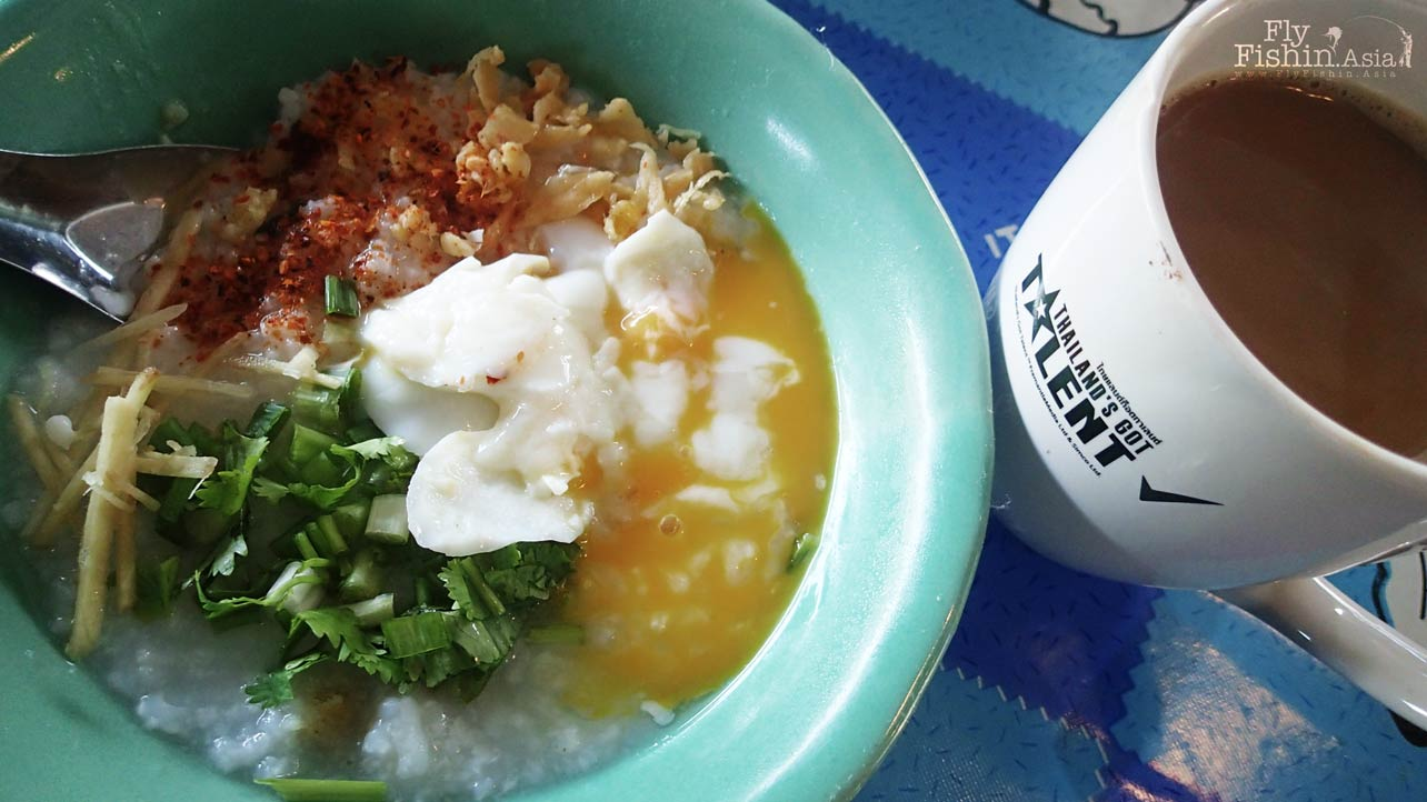 Thai style porridge with egg and coffee