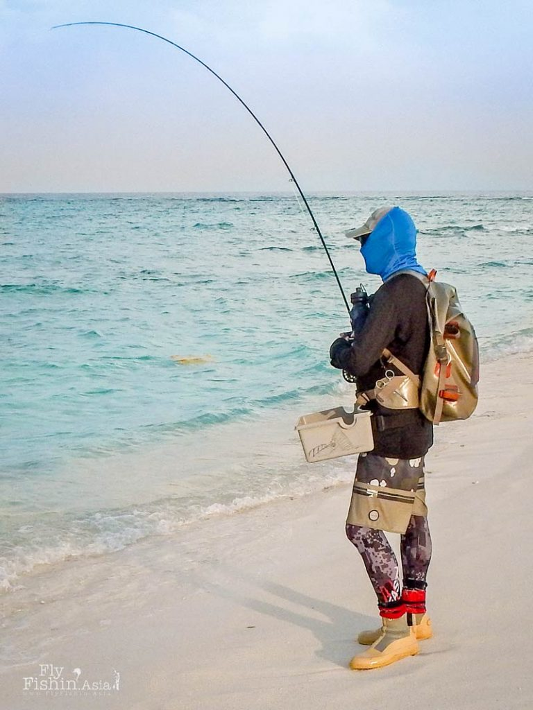 Fully covered for sun protection and using the Fishpond roll-top backpack