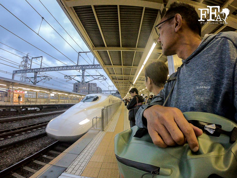 Waiting to board the Shinkansen bullet train