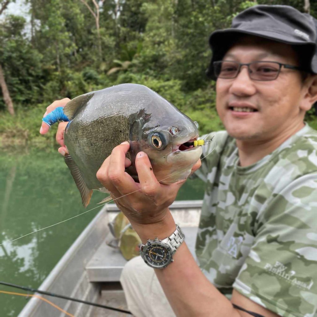 JW and a pacu caught with a hopper fly